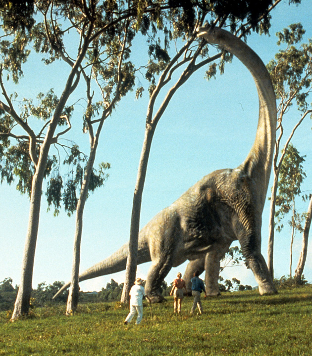 A brontosaurus eats leaves in a scene from the film 'Jurassic Park', 1993. (Photo by Universal/Getty Images)